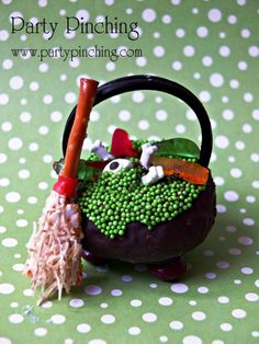 Halloween Donut Cauldron with sprinkles, candy bones and shredded wheat broomstick