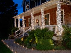 Mass outdoor lights for a magical effect. Take traditional Christmas lights in a different direction by wrapping them tightly around columns, railings and other front-entry architectural details to yield an extra-radiant shimmer. You also could use this technique with tree trunks, mailboxes, trellises or any other part of the landscape that lends itself.