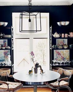 "dining room paint colors (this is ""soot #2129-20"" by Benjamin moore) bakers rack, black wall, baker rack"