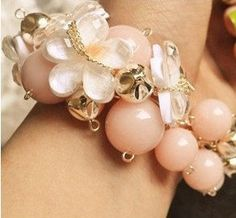 Lovelovelove shiny. Girly Flower Charm Bracelet. $8.99, via Etsy.