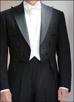 Fit details worth noting on this white tie rig: The waistcoat doesn't extend past the bottom of the tailcoat's front.  The trousers are a longer rise and sit higher on the waist, preventing the waistband from being visible and/or below the waistcoat. And as Will Boehlke will tell you, just don't forget to add white kidskin gloves.