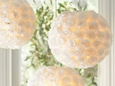 paper lanterns covered in fabric roses