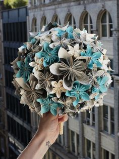 origami paper flower balls hung from ceiling.