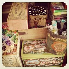 Vintage boxes and tins hold art supplies
