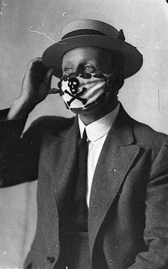 Compulsory mask, brought in to combat the flu epidemic after the World War, 1918-1919 / Sam Hood by State Library of New South Wales collection