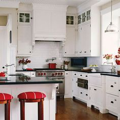 Notice the pops of red and the pretty white subway tile? We think it adds a little sparkle to this space.