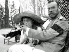 Anastasia shares a smoke with her father, Tsar Nicholas II two years before their assassination in 1916.