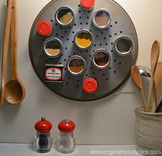 Small Kitchen Ideas: DIY Magnetic Spice Rack (this one uses a pizza pan and combo of magnetic spice jars and regular spice jars/tins with magnets glued to backs)