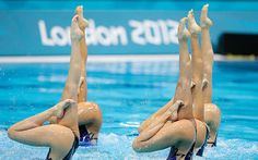 the Japanese team competes in the women's teams synchronised swimming technical routine