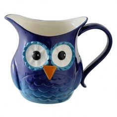 """Owl Drink Pitcher  $29.50  Who's thirsty? Our Out On A Whim Owl Pitcher holds a generous 40 oz. and features large, gazing eyes and bright, hand painted colors. Can even be used as a unique vase! Dishwasher safe. Arrives gift boxed.   Ceramic   9"""" x 5 1/2"""" x 7"""""""