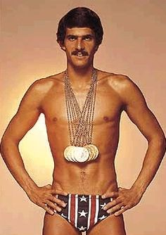 "Mark Spitz won seven gold medals at the 1972 Munich games. The man was the most decorated Olympic athlete until that Phelps guy stole his thunder. Phelps also tried to one up Spitz Lip Strip. One thing is for certain, Spitz isn't just ""treading water"" in that department. Sorry Michael, can't win em all...."