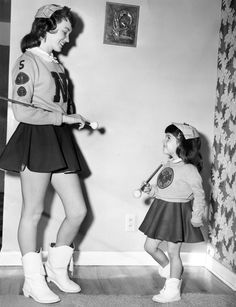 Diane Tadlock, 4, idolized Omaha North High sophomore Judy Oliver, a member of North's Baton Club. Their mothers made an outfit for Diane that is like Judy's in 1957. THE WORLD-HERALD