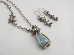 Aquamarine in a cage - 100% hand fabricated in sterling silver by JoDeneMoneuseJewelry, $155.00