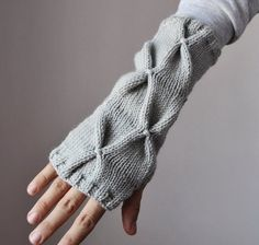 Love these but rather than buying them I want to remind myself to smock a pair made from the sleeves of a felted sweater.