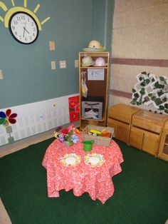 The toddler room at the Bright Horizons Lands' End Back-up Child Care Center in Dodgeville,WI created a garden atmosphere by adding a green grass rug, flowers, picnic table, garden tools and summer hats!​ The toddlers loved playing in their indoor garden!