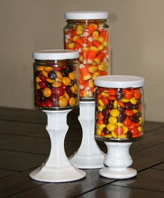 Seasonal Candy Jars. Spray paint glass candle holders and glue on glass bottles (mine were jam jars.) Fill with your favorite seasonal candy.