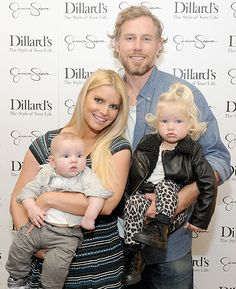 Jessica Simpson and fiance Eric Johnson pose with daughter Maxwell and son Ace at the Dillard's event for her clothing line.