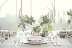 White antler centerpiece - more dramatic, but could be a neat entrance piece or escort card table decor