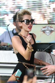 Sunglasses... Oh Miley.