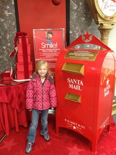 Dropping off her letter to Santa.