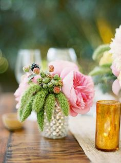 Wedding centerpiece of pink garden roses and blackberrys in a mercury vase | Brides.com