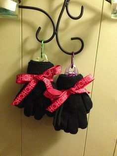 Purse size hand sanitizes tucked inside a pair of gloves, roll the wrists together. Tie ribbon just under the wrist bands. An inexpensive useful holiday gift for that, teacher, co-worker, bus driver, mail man ext...