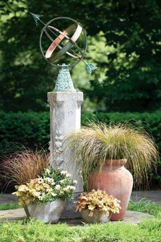 Year-round color and interest in this planting vignette. Photo of Carex 'Toffee Twist' courtesy Proven Winners. color design, plantlandscap idea, yearround color, outdoor project, driveway, season color, garden idea, plant vignett