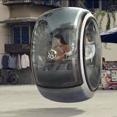 """LOOK, Mom. no wheels!"" Volkswagen's concept car that travels by using magnetic force to float..."