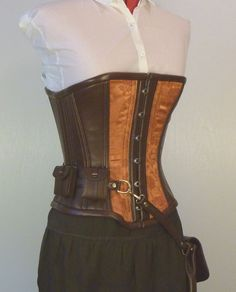 Steampunk Utility Corset   from LillysWorkshop on etsy.com  Copper steampunk utility corset with two side pockets and purse sized pouch for the adventurous steampunk looking for both function and elegance.