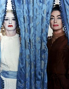 Bette Davis and Joan Crawford, in What Ever Happened to Baby Jane?  The wig Bette Davis wears throughout the film had, unbeknownst to both leads, been worn by Joan Crawford in an earlier MGM movie. Because it had been re-groomed, Crawford didn't recognize it. (via)