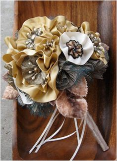 Going very non traditional for our wedding, I used Kraft Paper Scissors designs to create custom fabric flower bouquets, boutineers, and wrist corsages.  I loved the uniqueness of this!