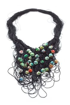 Necklace | Bridget Catchpole. 'Enmeshed'.  Sterling silver, up-cycled plastic and cord.