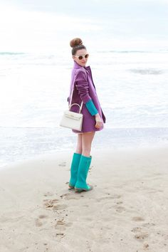 Purple coat, blue wellies