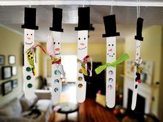 Snowmen made from tongue depressors were made by second graders at Heard...