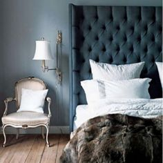 Teal headboard and faux fur throw