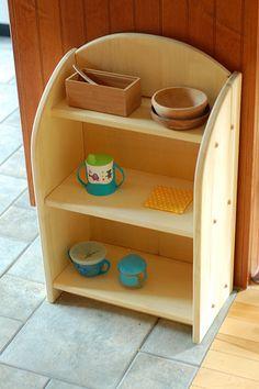 Montessori kitchen area.  ::::have J make this for under kitchen counter...for kid bowls, utensils, cloth napkins, etc.