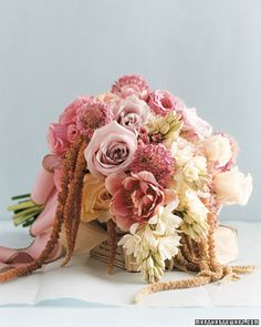 Antique Romance: From the bold hues of the scabiosas and tulips to the softly shaded roses, the range of pinks in this bouquet spells romance.