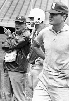 Husker coach Bob Devaney instructs quarterback Van Brownson on the sideline as assistant Tom Osborne looks on in 1969. THE WORLD-HERALD