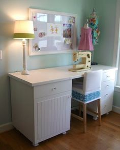 Another great craft table using  kitchen cabinets.