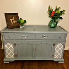Update a 1950s stereo cabinet with new fabric & fresh paint everywhere -- even on the hardware.
