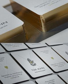 Luxurious Business Card Design - like the metallic edge paint and the design feels uncluttered, simple, but elegant