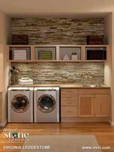 Organized laundry with brick backsplash..