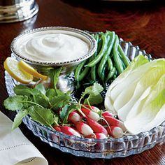 Whipped Lemon Aïoli—Indulgent and lightly flavored, this dip is the perfect partner to colorful spring veggies such as green and purple endive; assorted radishes; and blanched, chilled asparagus and haricots verts (tiny green beans). | SouthernLiving.com