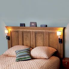 I love this stained headboard made out of a door.  I also love those light sconces.