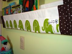 book sling -  white green elephant jungle- book storage shelf gender neutral nursery decor. $25.00, via Etsy.