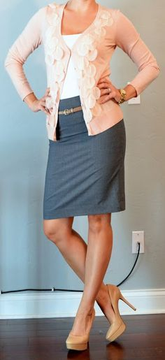 Dark teal pencil skirt with pale pink flowery sweater and white tank top.