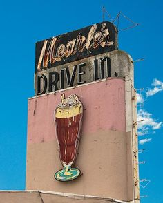 A fine art photography of the Mearle's Drive In sign.  #Route66 #VintageSigns #NeonSigns #MotherRoad #RoadsideAmericana #GhostSigns #Retro #VanishingAmerica #SmallTown #Abandoned #Rustic #Decay #RoadsideAttraction