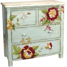 pale blue and floral painted dresser.