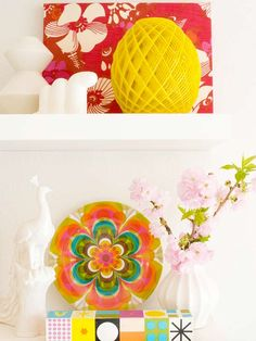 Great Idea! Paint floating shelves the same hue as your wall, then accessorize with accents in contrasting colors. For example, white shelves on a white wall nearly disappear and allow these colorful accessories to shine.