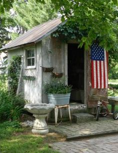 Perfect little potting shed or coop! I have the wash basin and the bird bath~ great taste this person has!!!!  hehehe